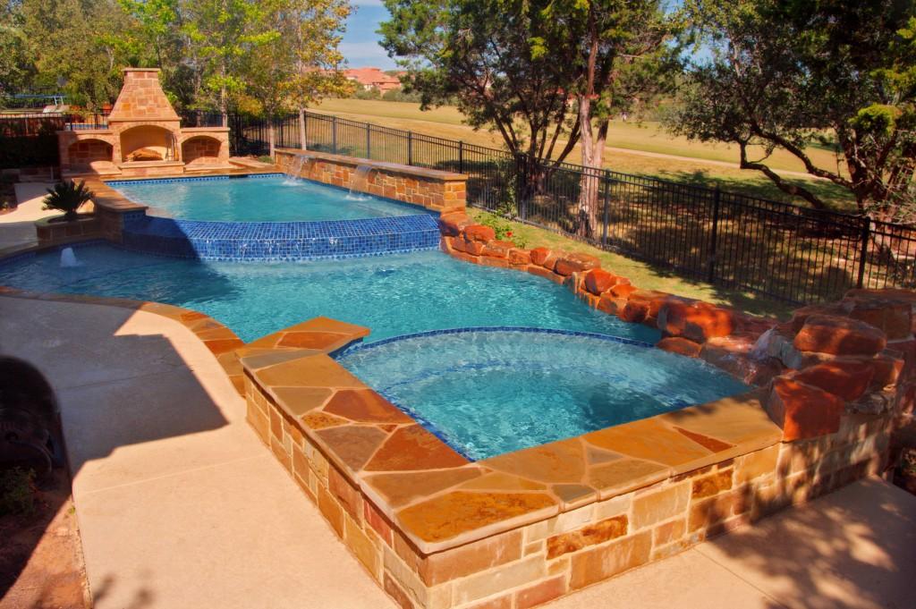 Residential pool designs freeform geometric vanishing edge for Residential swimming pool